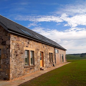 Extensive repairs to stone cottage and erection of contemporary side extension at Collairnie